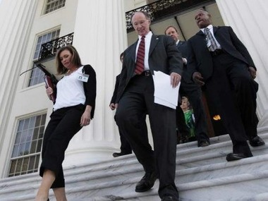 Rebekah Mason, left, and Gov. Robert Bentley descend the steps of the state capitol. (AL.com file photo)