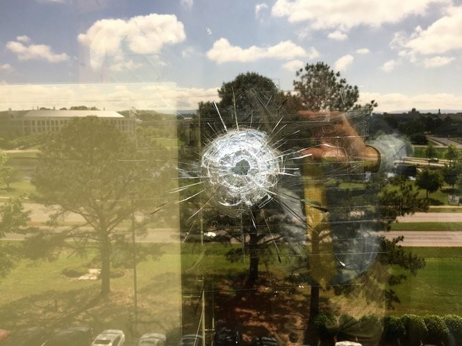 A high-velocity cartridge made this hole in double-pane glass in an office near that one occupied by Huntsville climate change skeptic Dr. John Christy over the Earth Day and March For Science weekend. Seven shots in all were fired at the building, and Christy believes his floor was targeted. (Lee Roop/lroop@al.com)