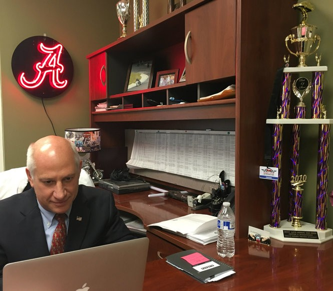 Dr. James Beretta, candidate for U.S. Senate in Alabama, sits behind the desk in his Pelham office. Beretta treats many athletes and is close to several former University of Alabama football players. A former ice hockey player and motorcycle rider, the trophies are for his own past sports victories. (Lee Roop/lroop@al.com)