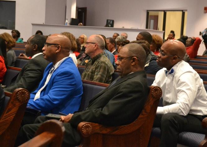 Audience members listen carefully to Senate candidate Doug Jones speaking in Huntsville two days before the Dec. 12 election. (Lee Roop/lroop@al.com)