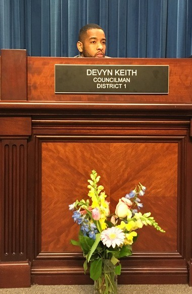 An arrangement of flowers was placed in front of Huntsville City Councilman Devyn Keith's seat at Thursday's meeting. The flowers were in memory of a 3-year-old girl killed in a drive-by shooting in Keith's district. (Paul Gattis/pgattis@al.com)