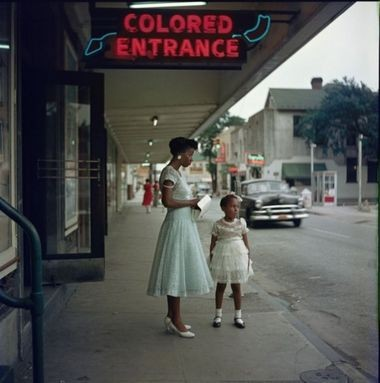 Mobile teacher Joanne Thornton Wilson and her niece, Shirley Kirksey, were photographed by Gordon Parks outside the Mobile Saenger Theatre in 1956. Parks was on assignment for Life magazine, which did not publish the photo at the time. (Courtesy of the Gordon Parks Foundation)