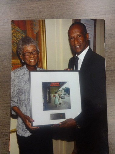 In 2013, Joanne Thornton Wilson, left, and her son Michael Wilson traveled to New York, where she was honored by the Gordon Parks Foundation. She also was presented with a print of Gordon Parks' iconic 1956 photo of her outside the Mobile Saenger Theatre. (Courtesy of Michael Wilson)