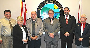 "Members of the Winfield, Ala., City Council unanimously approved a resolution in December 2014 declaring the city is ""owned"" by God and is a ""City under God."" Council members are, from left, Grant Webb, Gloria Stovall, Max Brasher, Mayor Randy Price, Rusty Barnes and Steve Martin. (Contributed by City of Winfield)"