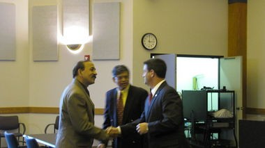 Madison Mayor Troy Trulock shakes hands with Indian Consul Anil Kumar before the press conference Thursday. Kumar watched, but did not comment.