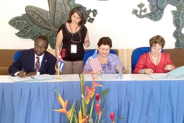 Participating in the May 21 signing of the international academic interchange agreement between the Auburn University College of Agriculture and two Cuban institutions were, seated, from left, Henry Fadamiro, assistant dean and director of the Office of Global Programs, Auburn College of Agriculture; Maria Irene Balbin Arias, chancellor, Agrarian University of Havana; and Ondina Leon Diaz, general director, Cuban National Center for Animal and Plant Health. (Auburn University photo)