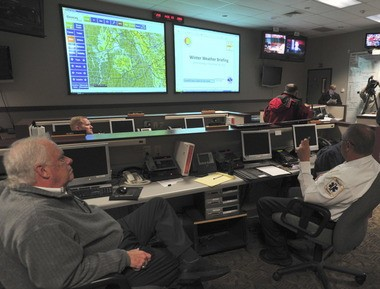 Huntsville officials sit in on a National Weather Service weather briefing in 2011 in anticipation of snow. (Eric Schultz/eschultz@al.com)