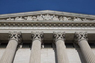 """The back entrance of the Supreme Court has the words """"Justice The Guardian of Liberty,"""" Monday June 29, 2015, in Washington. (AP Photo/Jacquelyn Martin)"""