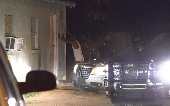 Members of Alabama's 4th Circuit Drug Task Force arrest a man Thursday night in the Selma area. (Ian Hoppe | ihoppe@al.com)