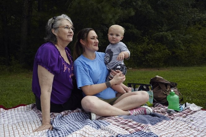 Casey Shehi has won her fight and now works to restore her reputation in her community, where she, son James, and her mom, Ann Sharpe, recently watched a soccer practice in Gadsden. (Rob Culpepper for ProPublica and AL.com)