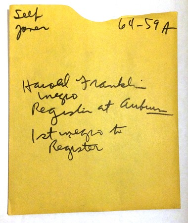 """Handwriting on an envelope of Birmingham News photo negatives identifies the contents: """"Harold Franklin, negro, registers at Auburn. 1st negro to register"""""""