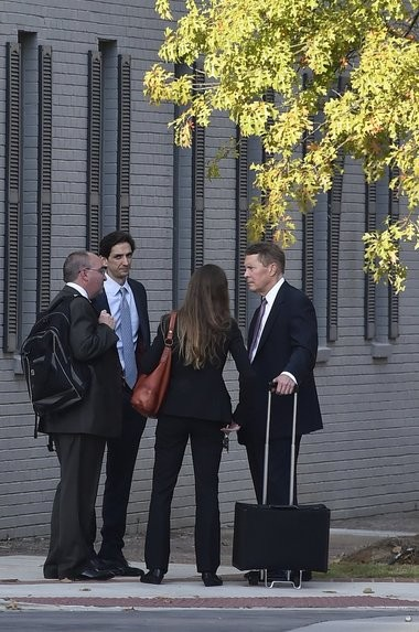 Federal prosecution gather outside the Huntsville courthouse on Oct. 29, 2015. The three prosecutors are Assistant U.S. Attorney Russell Penfield, left, Saeed Mody of the U.S. Department of Justice, center, and Assistant U.S. Attorney Robert Posey, right. An FBI agent stands with her back to the camera. (Bob Gathany/bgathany@al.com)