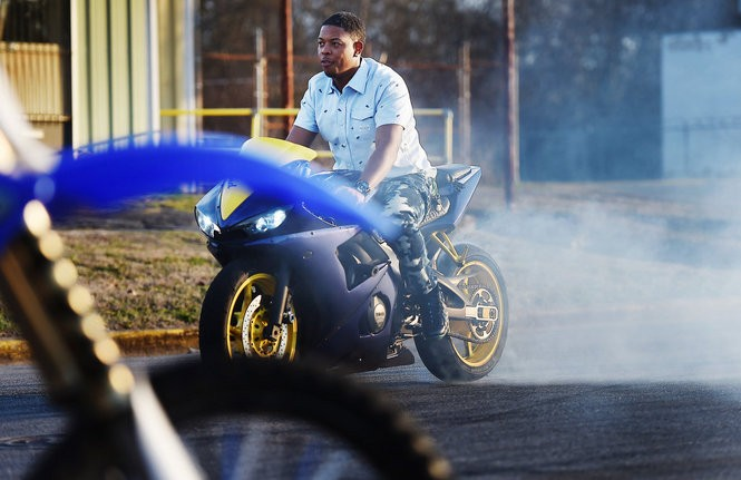 Ray Square, aka Djay Dirty Red, shows off his burnout and donut skills. (Tamika Moore/tmoore@al.com)