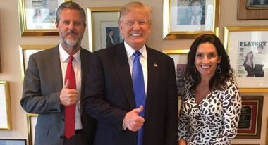 Jerry Falwell Jr. and his wife, Becki, with presumptive Republican presidential nominee Donald Trump. A framed copy of Playboy magazine can be seen in the background.