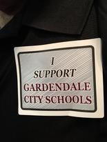 """Supporters of the creation of a Gardendale school system wore stickers bearing the phrase """"I Support Gardendale City Schools"""" to a Friday court hearing in federal court in Birmingham (Connor Sheets 
