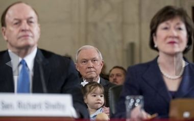 Attorney General-designate, Sen. Jeff Sessions, R-Ala. holds one of his granddaughters between Sen. Richard Shelby, R-Ala., left, and Sen. Susan Collins, R-Maine, right, on Capitol Hill in Washington, Tuesday, Jan. 10, 2017, prior to testifying at his confirmation hearing before the Senate Judiciary Committee. (AP Photo/Andrew Harnik)