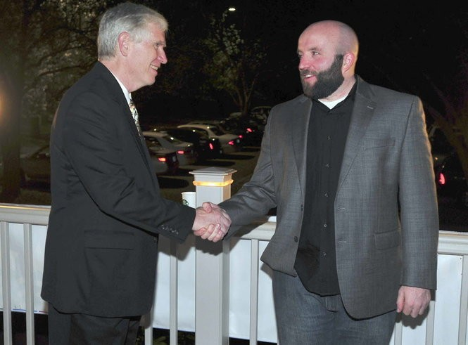 Huntsville radio host Dale Jackson (r.) shakes hands with Rep. Mo Brooks in this March, 13, 2012 file photo.