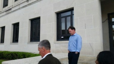 Dr. John Patrick Couch, in blue, emerges from the federal courthouse in Mobile. (Casey Toner/ctoner@al.com)