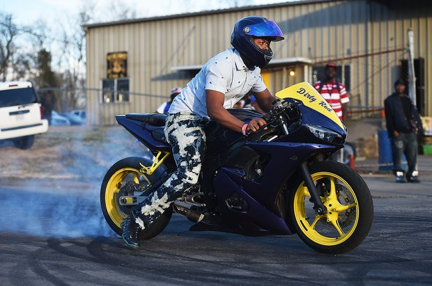 A member of the Vikings Motorcycle Club shows off his ride outside the group's headquarters on Jan. 31, 2016. (Tamika Moore/tmoore@al.com)