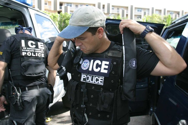 A U.S. Immigration and Customs Enforcement (ICE) agent prepares for a raid. Across the nation, ICE is widening its net of potential immigration enforcement targets. (U.S. Immigration and Customs Enforcement)