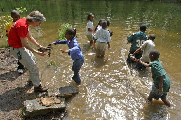 A Camp McDowell worker with a group of Tuscaloosa children in 2005.