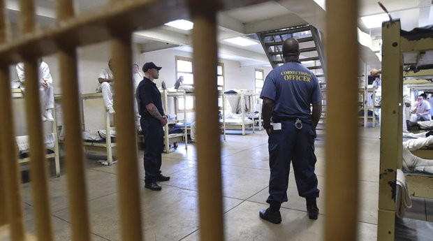 Correctional officers watch over inmates in their bunks at Draper Correctional Facility Monday, Feb. 6, 2017, during a media tour of the prison in Elmore, Ala. (Julie Bennett/jbennett@al.com)