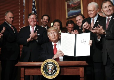 President Donald Trump holds up a signed Antiquities Executive Order during a ceremony at the Interior Department in Washington, Wednesday, April, 26, 2017. In coastal Alabama, local politicians and anglers are holding out hope that Trump might consider similar action to extend the red snapper season for recreational anglers. (AP photo)