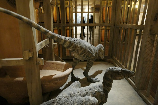Replica dinosaurs in a cage aboard the ark. Answers in Genesis, the group that built the Ark Encounter, believes that dinosaurs coexisted with humans. MUST CREDIT: Photo for The Washington Post by Luke Sharrett