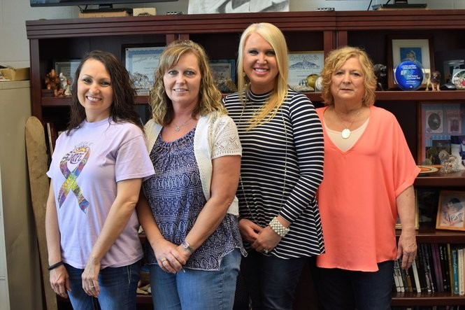 Teachers at Crossville High School say earning the trust of their students - about 75 percent of whom come from Hispanic families - is crucial to being effective in the classroom. From left, Amy Pointer, counselor; Angela Short, math teacher; Amy Dyar, library media specialist; and Sandi Uptain, retired school librarian and media specialist. (Anna Claire Vollers | avollers@AL.com)