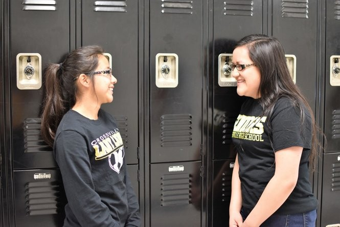 Brittany Casimiro, left, a junior, and Estrella Martinez, a senior, talk by the lockers at Crossville High School in April 2017. The friends grew up in Crossville and both plan to attend college after graduation. (Anna Claire Vollers | avollers@AL.com)