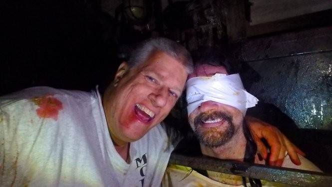 Russ McKamey, left, poses with a 'victim' at McKamey Manor, the extreme haunt that recently opened in Summertown, Tenn. and Huntsville, Ala. (Submitted)