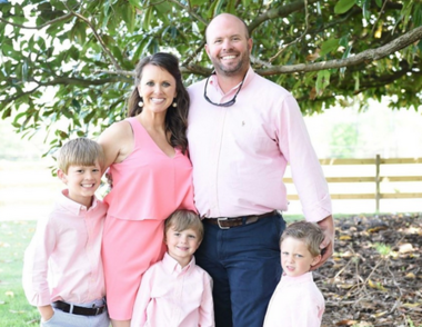 Courtney and Eric Waldrop stand with their sons Saylor, Wales and Bridge. Courtney is expecting sextuplets.