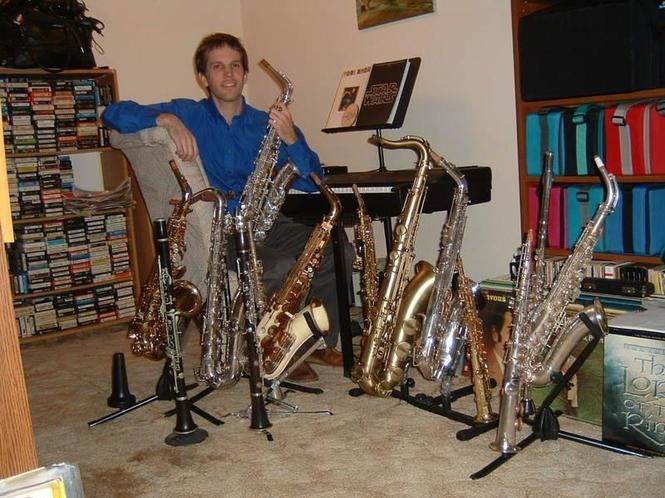 Rick Hightower poses with his horn collection. Police seized the instruments from his home in 2008 and have yet to return any of them.