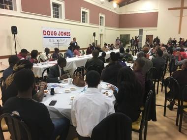 Doug Jones speaks at Maggie Street Baptist Church in Montgomery on Dec. 1, 2017.