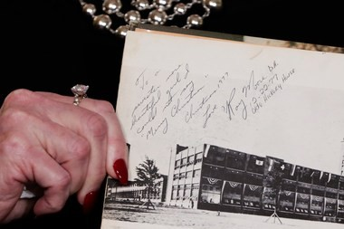 Beverly Young Nelson shows her high school yearbook signed by Moore, at a news conference, in New York, Monday, Nov. 13, 2017. (AP Photo/Richard Drew)