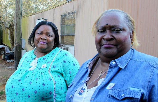 Perman Hardy drove sisters Pamela and Almedia Rush (right) to their polling station in Lowndes County. (Connor Sheets | csheets@al.com)