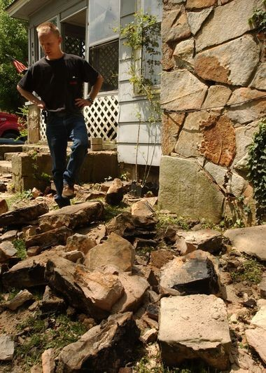 Brent Bentley steps over rubble from damage caused to his house when his chimney collapsed when an earthquake rocked the town of Valley Head on April 29, 2003. An overnight earthquake hits the towns of Valley Head and Mentone, near the epicenter of the quake, damaging houses and school, though with no injuries reported.