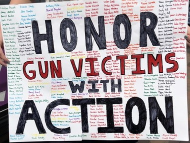 Hope Smith of Alabaster created a sign with the names of victims of school and church shootings to honor them.