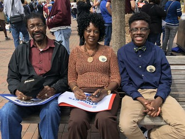 J'Corion Johnson, an 8th grader at Birmingham's Phillips Academy, with his grandmother and great-grandfather at the March for Our Lives at Railroad Park on March 24.