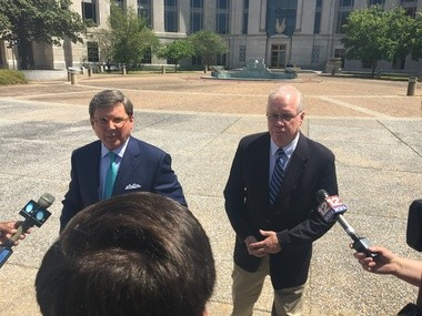 Attorney Joe Espy, left, with Marty Connors, after Connors entered a not guilty plea today in federal court in Montgomery.