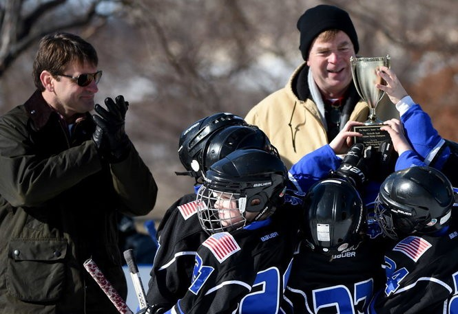 Huntsville Mayor Tommy Battle hands out an outdoor youth hockey trophy in a typical mayoral duty. (Eric Shultz/Huntsville Times)
