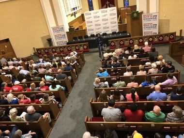 Zo Shuaku, an anti-gun violence activist who was shot by a stray bullet while sleeping on July 20, speaks at the March for Our Lives Road to Change town hall meeting in Birmingham, Ala.
