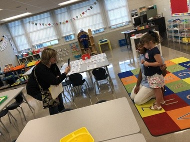 University Charter School kindergarten teacher Brittany Williams poses for a picture with her student during the school's open house in Livingston, Ala., on Aug. 9, 2018.