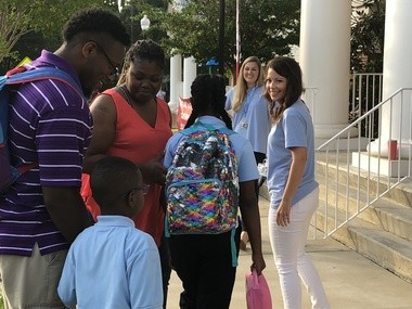Fourth-grade teacher Morri Mordecai with families during the first day of school at University Charter School in Livingston, Ala., on Aug. 13, 2018.