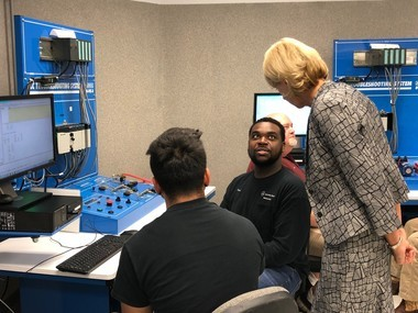 U.S. Education Secretary Betsy DeVos listens to students at Shelton State Community College explain what they are learning during her 'Rethink School' tour to Tuscaloosa on Oct. 4, 2018.