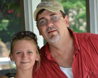 This undated photograph released by the families of Jessica Chambers and her sister Amanda Prince shows Jessica Chambers and her father Ben Chambers taken in Courtland, Miss. Mississippi authorities have launched a homicide investigation into the death of the 19-year-old woman who was found badly burned on a road near her car that was on fire in Panola County, Miss. Chambers was doused with a flammable liquid and set on fire Saturday, Dec. 6, 2014, said Panola County Sheriff Dennis Darby. (AP Photo/Chambers-Prince Families)