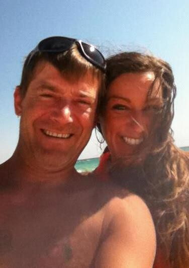 Steven Hooven, left, and wife Michelle Hooven pose at the beach in January 2013. Months later, he would find himself sentenced under Alabama's habitual offender law to life in prison for participating in a large marijuana growing operation. His wife and father say he never has been accused of violence. (Photo courtesy Michelle Hooven)
