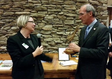 Casi Callaway, executive director of Mobile Baykeeper, presents an environmental award to Mobile Mayor Sandy Stimpson during Mobile Baykeeper's fundraising gala, Bay Bash, on Oct. 24 at Five Rivers Delta Resource Center. (Sally Pearsall Ericson | sericson@al.com)