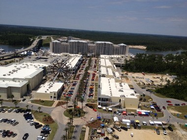 The Wharf is shown in an aerial photo taken on April 26, 2013, in Orange Beach, Ala. Wharf Retail Properties LLC has approved a franchise application with SpringHill Suites by Marriott to build a hotel next to the Orange Beach Event Center at The Wharf, which is located onthe other side of the bridge shown on the left. (Ken Grimes/City of Orange Beach)