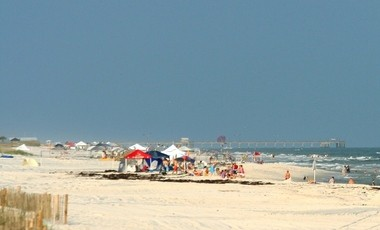 Looking east from Little Lagoon Pass, vacationers line West Beach in Gulf Shores, Alabama, in June 2013. In order to keep the beaches clean and to encourage recycling, the Gulf Shore City Council is implementing a recycling program and litter ordinance. As part of the plan, trash and recycling receptacles will be added to areas such as West Beach. (Marc D. Anderson/manderson@al.com)